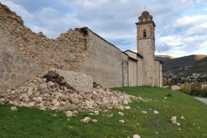 A damaged wall along a church is seen in Norcia, central Italy, October 27, 2016. REUTERS/Emiliano Grillotti