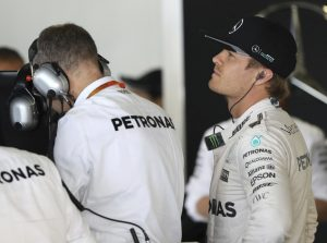 Mercedes driver Nico Rosberg of Germany waits in his team garage during the first practice session for the Japanese Formula One Grand Prix at the Suzuka International Circuit in Suzuka, Japan, Friday, Oct. 7, 2016. (AP Photo/Eugene Hoshiko)