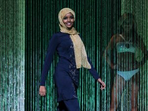 Halima Aden wore a navy blue, embroidered burkini — a full-body bathing suit — during the swimsuit competit