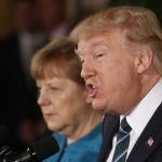 U.S. President Donald Trump speaks as German Chancellor Angela Merkel listens as they hold a joint news conference in the East Room of the White House in Washington, U.S., March 17, 2017. REUTERS/Jonathan Ernst