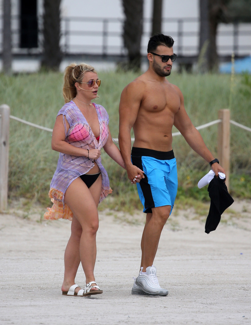 Britney Spears wears a pink bikini as she takes a jet ski ride with boyfriend Sam Asghari on the beach in Miami